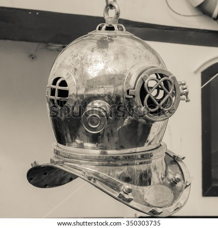 Copper old diving helmet, close up sepia - stock photo