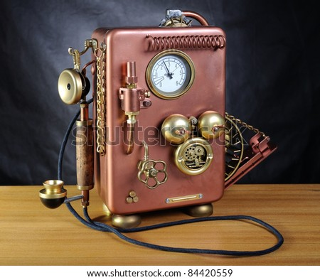 Copper phone on a dark background. Style steampunk. - stock photo