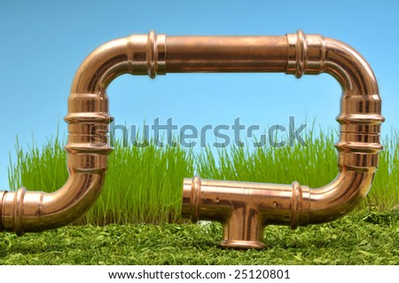 copper pipe in front of nature. abstract energie - stock photo