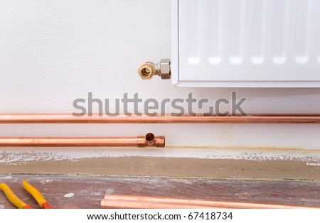 copper pipes and pliers and radator ready for plumbing - stock photo