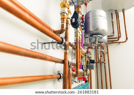 copper pipes engineering in boiler-room - stock photo