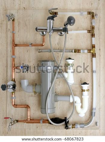 copper plumbing installation and polyethylene pvc diagram stoves valves drain - stock photo
