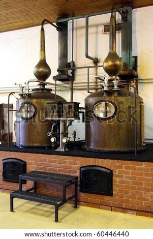 Copper potstills for the manufacture of brandy alcohol - stock photo