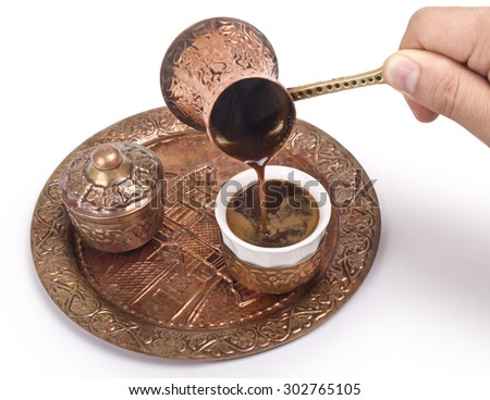 Copper set for making turkish coffee with spices, coffee is ready to be served. - stock photo