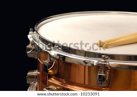 copper snare drum on black - stock photo