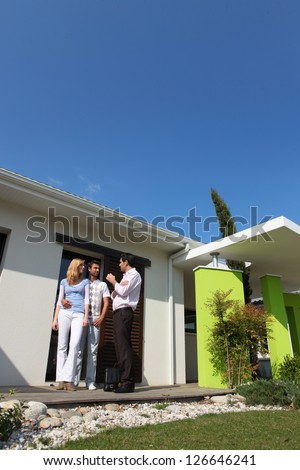 copule and house - stock photo