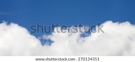 Copy space. Big fluffy clouds against  blue sky - stock photo