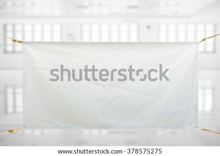 Copy space for text on white vinyl banner on white storehouse  background .Clipping path - stock photo