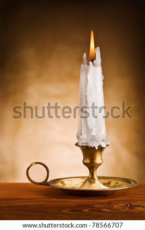 copy space image of ablaze candle in old candlestick - stock photo