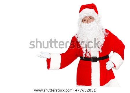 Copy space in hand of Santa. Happy Santa Claus standing on white background