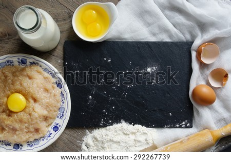 copy space - meat, flour, meat, eggs, meat dumplings- preapering for cooking - stock photo