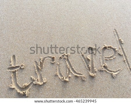 Copy space of travel words on sand beach texture background. Travel concept.
