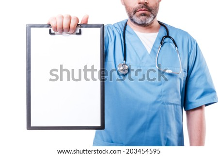 Copy space on his clipboard. Confident mature doctor looking at camera and showing clipboard with copy space on it while standing isolated on white - stock photo