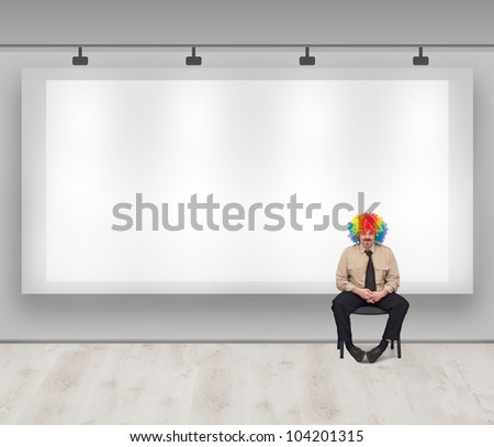 Copy space with clown - marketing banner and man with colorful wig - stock photo