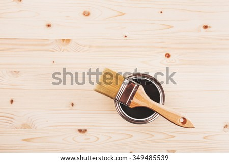 Copy space with paint brush on can lying on wooden clean table. Top view. Copyspace. - stock photo