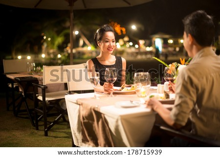 Copy-spaced image of a couple in-love having romantic dinner  - stock photo