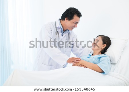 Copy-spaced image of a doctor comforting his senior patient in the hospital - stock photo