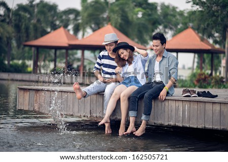 Copy-spaced image of a friendly team having fun with the water together - stock photo