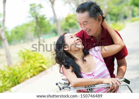 Copy-spaced image of a happy senior couple bonding in the park - stock photo