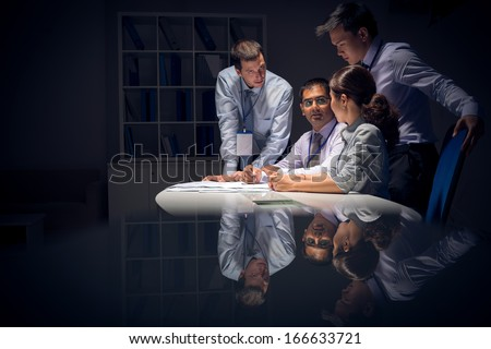 Copy-spaced image of a modern business team working in the night before deadline - stock photo