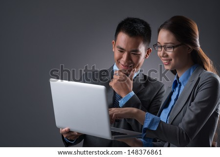 Copy-spaced image of business colleagues networking over a grey background