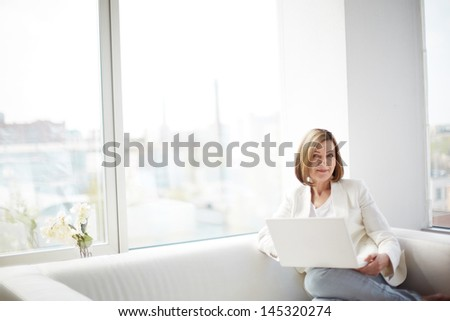 Copy-spaced portrait of a lovely business lady with a laptop