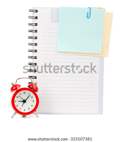 Copybook with stickers and alarm clock on isolated white background, top view