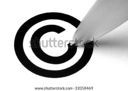 Copyright sign with tip of pen, on white. - stock photo