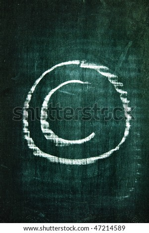copyright symbol written with a chalk on a blackboard - stock photo