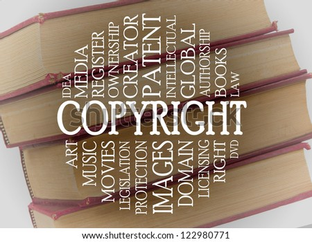 Copyright word cloud concept with a background of books - stock photo