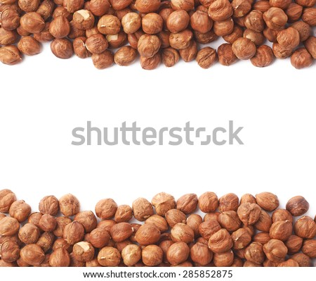 Copyspace background composition with the borders made of hazelnuts isolated over the white background - stock photo