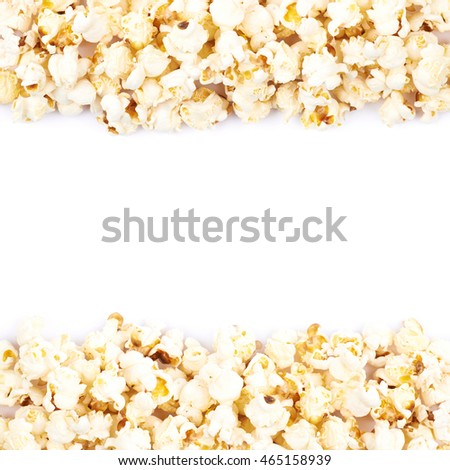 Copyspace background composition with the borders made of popcorn flakes isolated over the white background