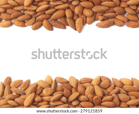 Copyspace background composition with the borders made of the multiple almond seeds isolated over the white background - stock photo