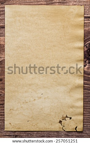 copyspace background vintage blank paper on old wooden board with place for your text  - stock photo