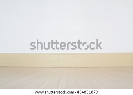copyspace background with an empty white wall with a hardwood wooden floor - stock photo