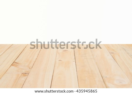Copyspace background with an empty white wall with a hardwood wooden floor below with large copy space for your text or advertisement - stock photo