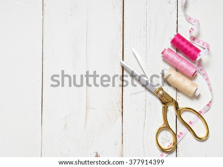 Copyspace frame with sewing tools and accessories - stock photo