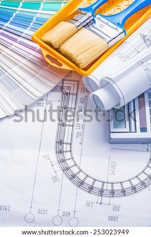 copyspace image paintbrushes paint can rolled blueprints color palette calculator  - stock photo
