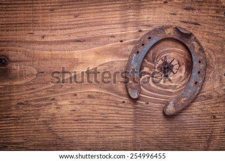 copyspace image the old rusty horseshoe on vintage wooden board happy concept horizontal version  - stock photo