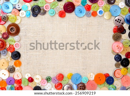 Copyspace image with multicolored sewing buttons - stock photo