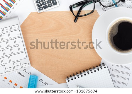 Copyspace on contemporary workplace with financial papers, office supplies and coffee cup