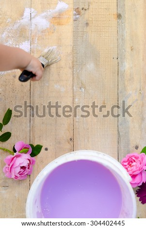Copyspace picture of kid's hand painting wooden board  - stock photo