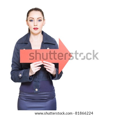 Copyspace Portrait Of A Business Lady Holding A Red Arrow Sign Pointing To The Right In A Depiction Of Forward Thinking, Guidance And Future Direction, On White - stock photo