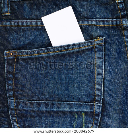 Copyspace white calling card in a back pocket of a navy blue denim jeans as a background composition - stock photo
