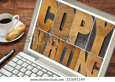 copywriting word in letterpress wood type printing blocks on a laptop with cup of coffee - stock photo