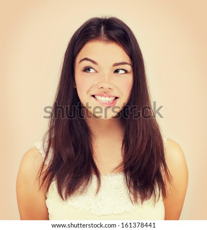 Coquette.Beauty portrait of a young brunette woman  biting her lips.  - stock photo