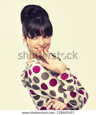 Coquette.Beauty portrait of a young brunette woman with beautiful smile - stock photo