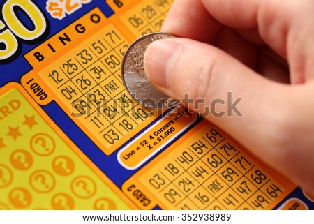 Coquitlam BC Canada - June 02, 2015 : Woman scratching lottery tickets. The British Columbia Lottery Corporation has provided government sanctioned lottery games in British Columbia since 1985.. - stock photo