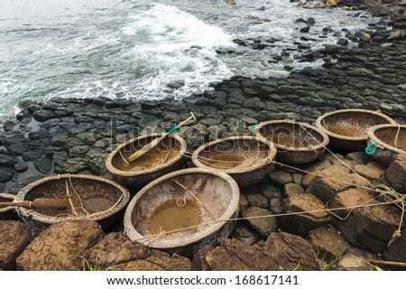 Coracles in basalt rocks of the famous causeway in Tuy An, Phu yen Vietnam - stock photo