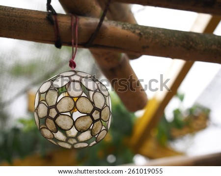 Coral ball decoration on bamboo sticks - stock photo